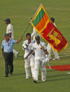 Lahiru Thirimanne and Angelo Mathews walk off after Sri Lanka's win