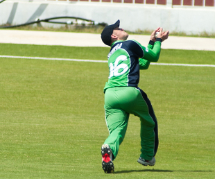 William Porterfield, with three catches and 77, led Ireland to a comfortable six-wicket win over UAE in Sharjah