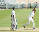 Nikhil Dutta completes his bowling action