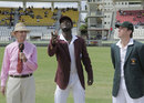 Darren Sammy tosses the coin as Brendan Taylor looks on