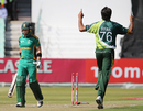 Mohammad Irfan celebrates after his second wicket in two balls