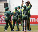 Mohammad Irfan is congratulated by his team-mates