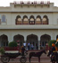 Mounted footmen wait to escort guests in a horse-drawn carriage at Rambagh Palace, Jaipur, October 18, 2010