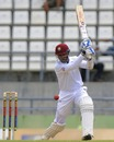 Denesh Ramdin drives on the off side