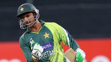 Shoaib Malik celebrates after hitting the winning runs
