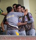 The Pakistan players celebrate their victory