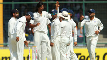 Ishant Sharma and team-mates celebrate Phillip Hughes' wicket
