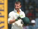 Phillip Hughes checks his helmet after being struck by a bouncer, India v Australia, 4th Test, Delhi, 1st day, March 22, 2013