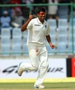 R Ashwin celebrates the wicket of Mitchell Johnson