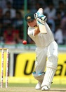 Steven Smith drives down the ground