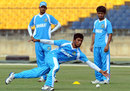 Anamul Haque stops a ball during a practice session in Hambantota