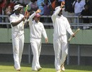 Darren Sammy, Shivnarine Chanderpaul and Shane Shillingford walk around the ground