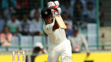 Cheteshwar Pujara drives down the ground