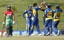 Thisara Perera celebrates the wicket of Anamul Haque with team-mates