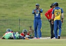 Tillakaratne Dilshan gestures to Bangladesh batsmen who take evasive action from an insect attack