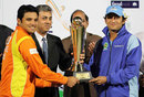 Lahore Lions' captain Azhar Ali and Karachi Zebras' captain Faisal Iqbal with the trophy