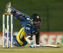 Kumar Sangakkara rushes to make his ground