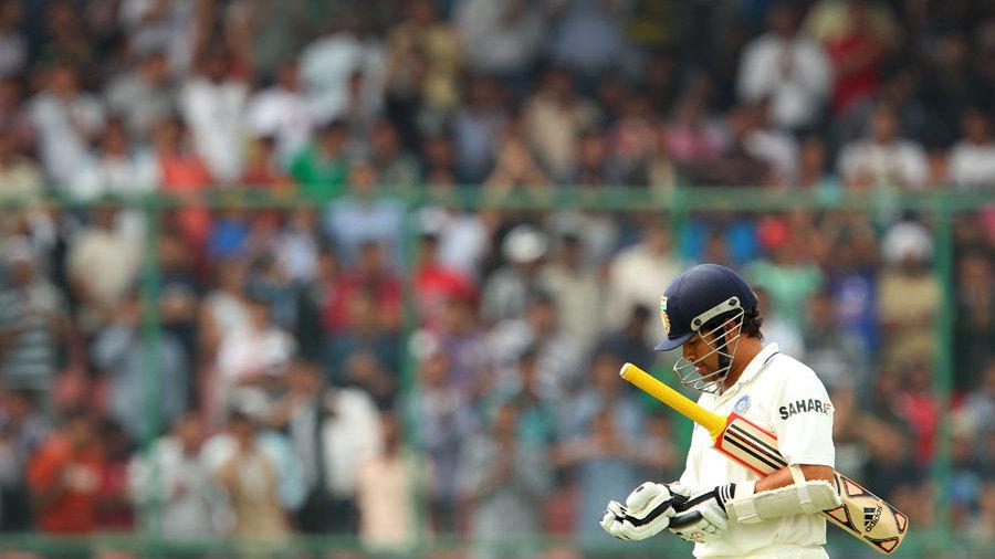 Sachin Tendulkar walks back after being dismissed