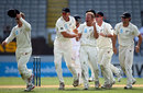 Neil Wagner celebrates with team-mates after getting Ian Bell