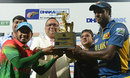 Mushfiqur Rahim and Angelo Mathews with the trophy