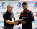 Waqas Barkat receives his Man of the Match award for his century against Maldives at the ACC Twenty20 Cup 2013 in Kathmandu