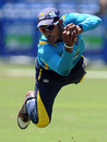 Kithuruwan Vithanage dives to take a catch during a practice session