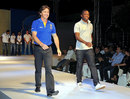 Brad Hogg and Fidel Edwards walk the ramp at a Rajasthan Royals event, Jaipur, April 2, 2013