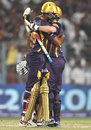Yusuf Pathan and Eoin Morgan embrace one another after leading Kolkata Knight Riders to victory