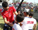Kevin Pietersen signs autographs on the sidelines of the game
