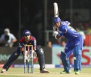 Stuart Binny gets into position to smash the ball