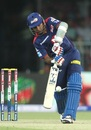 Mahela Jayawardene drives down the ground
