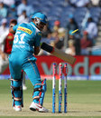 Manish Pandey looks back as his stumps are disturbed, Pune Warriors v Kings XI Punjab, IPL, Pune, April 7, 2013