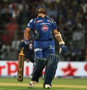 Sachin Tendulkar reacts after being run out