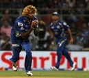 Lasith Malinga takes a return catch to dismiss Kedar Jadhav, Mumbai Indians v Delhi Daredevils, IPL, Mumbai, April 9, 2013