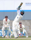 Moeen Ali goes down the ground on his way to a half-century, Lancashire v Worcestershire, County Championship, Division Two, Old Trafford, 1st day, April 10, 2013
