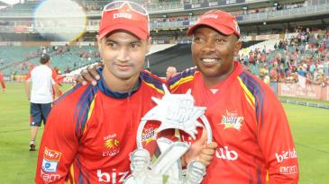 Lions captain Alviro Petersen and coach Geoff Toyana hold the Twenty20 trophy