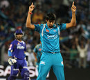 Rahul Sharma celebrates Ajinkya Rahane's wicket