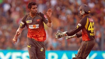 Ashish Reddy and Parthiv Patel celebrate a wicket