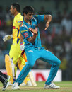 Rahul Sharma celebrates Dwayne Bravo's wicket