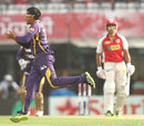 Sunil Narine takes a catch off his bowling to dismiss Azhar Mahmood