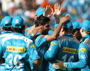Bhuvneshwar Kumar is congratulated by team mates after picking up a wicket