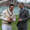 Graeme Smith receives his Surrey cap from Richard Thompson