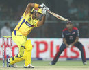 Suresh Raina drives through the off side