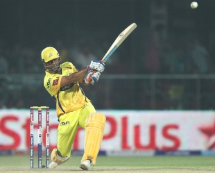 MS Dhoni slugs one down the ground, Delhi Daredevils v Chennai Super Kings, IPL, Delhi, April 18, 2013