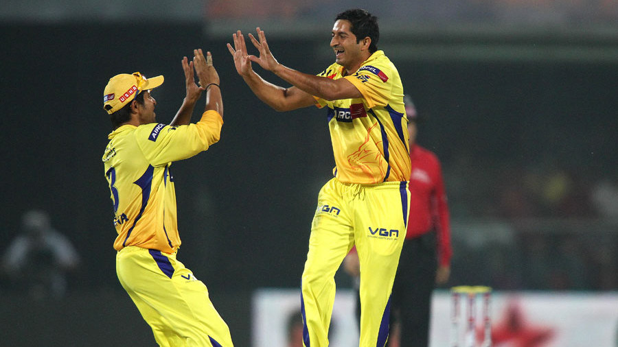 Suresh Raina and Mohit Sharma celebrate a wicket