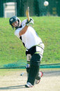 Andrew Birch clubs one during a South Africa Emerging Squad nets session, Pretoria, April 18, 2013