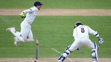 Mark Wallace shows his excitement as Moeen Ali is bowled
