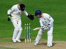 Catch that: The ball gets trapped between Phil Mustard's legs, Warwickshire v Durham, County Championship, Division One, Edgbaston, 3rd day, April 19, 2013