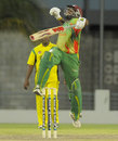 Windward Islands captain Liam Sebastien celebrates after scoring the winning runs