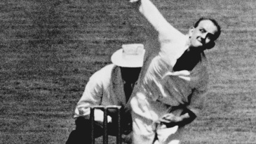 Frank Tyson bowls in a tour game